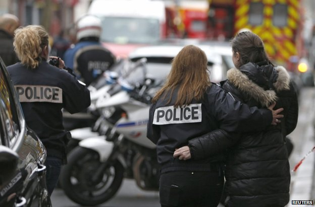 Police officers near the site of a shooting in Montrouge, south of Paris, 8 January