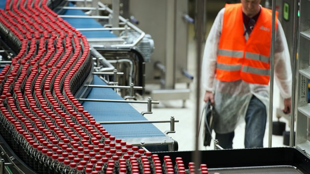 taken on June 7, 2013, in Clamart, near Paris, shows newly produced Coca-Cola soft drink bottles on an assembly line at a Coca Cola bottling plant.