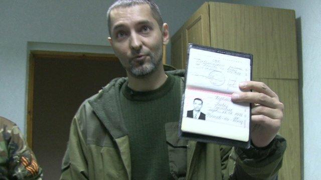 Russian man holds his passport