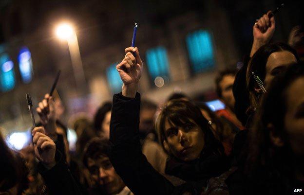 Demonstrators holding pens and pencils in Barcelona
