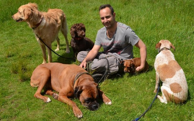 Renato Pagano and the five dogs he regularly walks