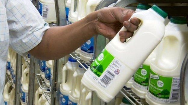 Man taking milk off shelf