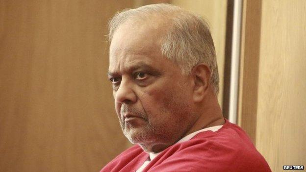 Krishna Maharaj sits in Circuit Court during a legal hearing in Miami, Florida, November 10, 2014