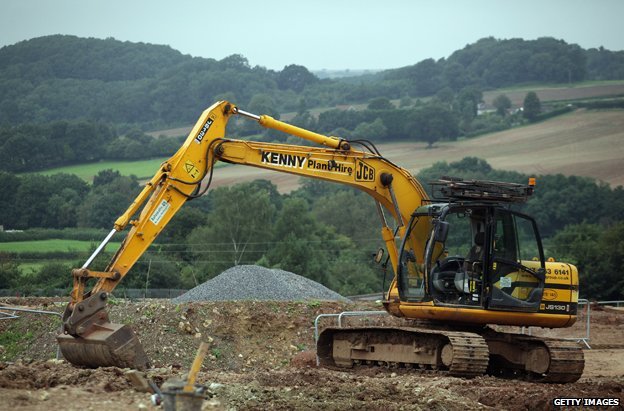 Big digger on edge of countryside