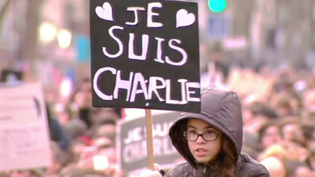 """Protester in Paris holds a banner displaying """"Je Suis Charlie"""" (I am Charlie)"""