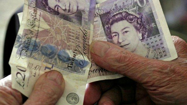 Pensioner holding money