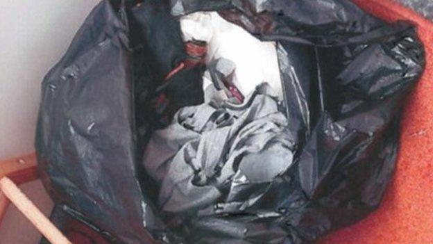 Bin bag of Breck's clothes