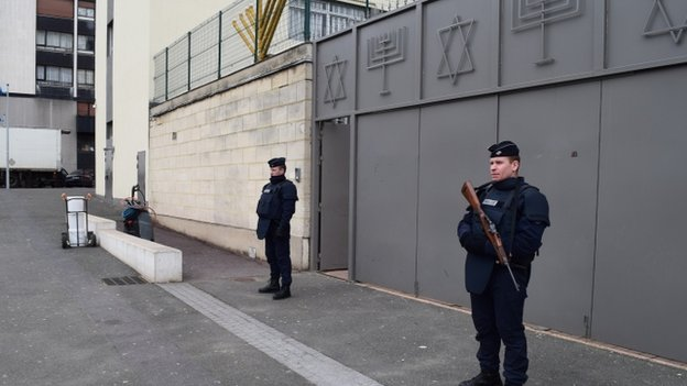 Policemen on guard outside a synagogue in Sarcelles