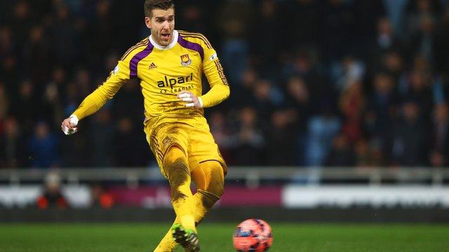 West Ham goalkeeper Adrian takes a penalty