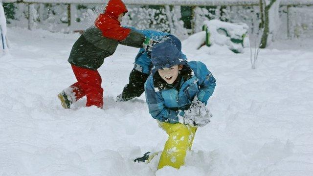 Children playing in snow in Scotland