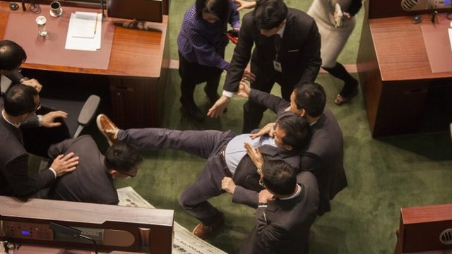 Pan-democratic lawmaker Raymond Chan Chi-chuen is forcibly removed from the chamber