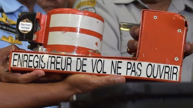 The cockpit voice recorder (CVR) from AirAsia flight QZ8501 is displayed by officials upon its arrival in Pangkalan Bun on January 13, 2015.