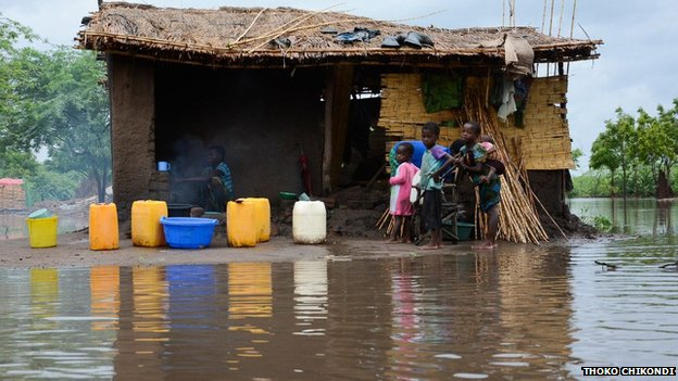 People seek refuge at one the few houses left in Matsukambiya village in the southern district of Chikwawa Malawi - January 2015