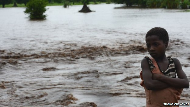 A boy stands whose family home was washed away by floods in the southern district of Chikwawa in Malawi on Tuesday 13 January 2015