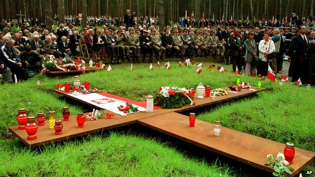 People prepare for the memorial ceremony on the site of the mass graves in the village of Katyn in western Russia