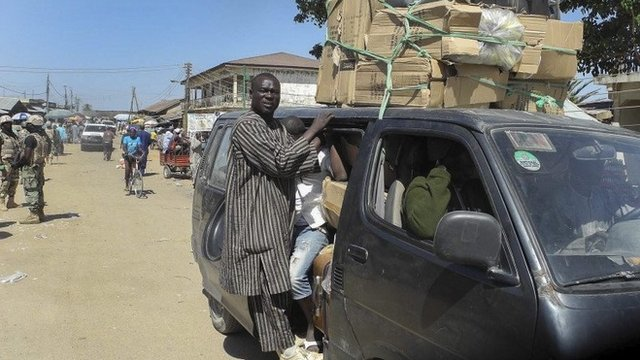 A photograph made available on 14 January 2015 shows Nigerians crammed into a bus fleeing the town of Mubi following recent attacks in north-east Nigeria, 9 December 2014