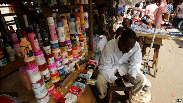 A trader selling beauty products, including skin lightening creams, in Guinea