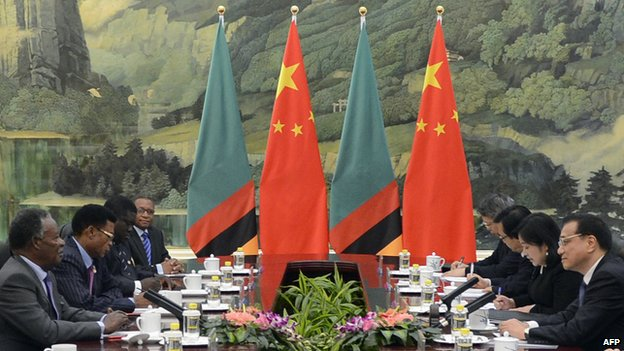 Chinese Premier Li Keqiang (R) talks with Zambia's President Michael Sata (L) during a meeting at the Great Hall of the People in Beijing on April 10, 2013.