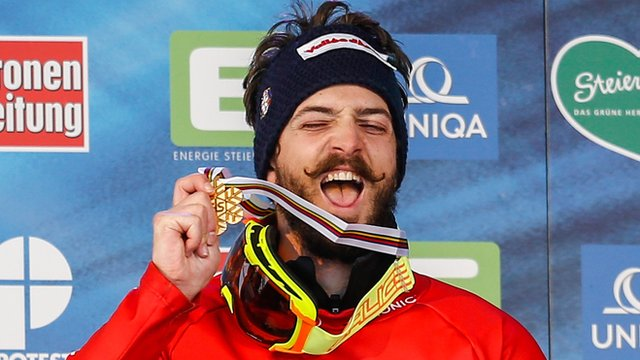 Italy's Luca Matteotti celebrates winning gold in the men's snowboard cross at the world championships in Austria