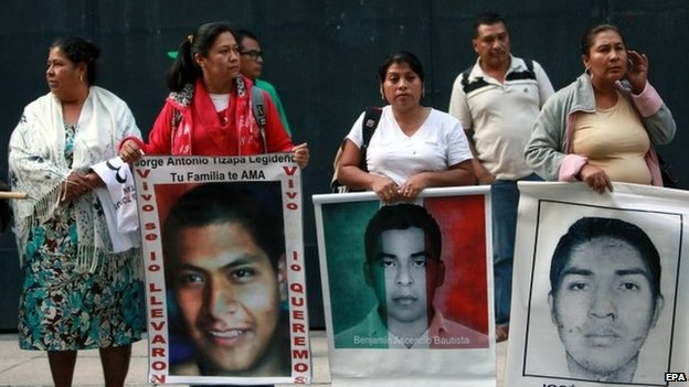 Relatives of the 43 missing students protest outside the Attorney General's office in Mexico City