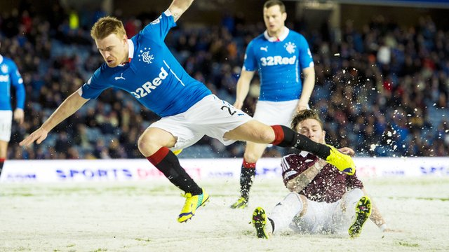 Rangers defender Steven Smith goes for a tumble in the game against Hearts