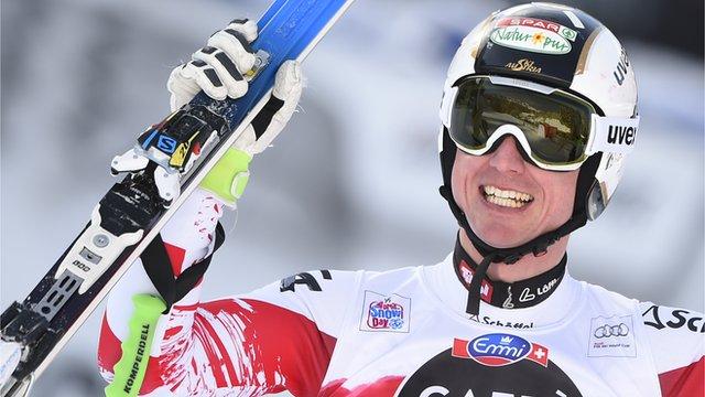 Austria's Hannes Reichelt celebrates winning the men's downhill race