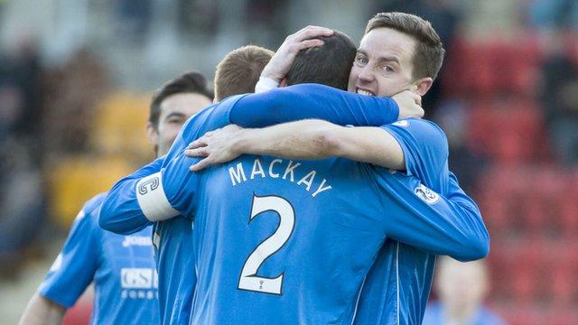 Steven MacLean congratulates Saints scorer Dave Mackay