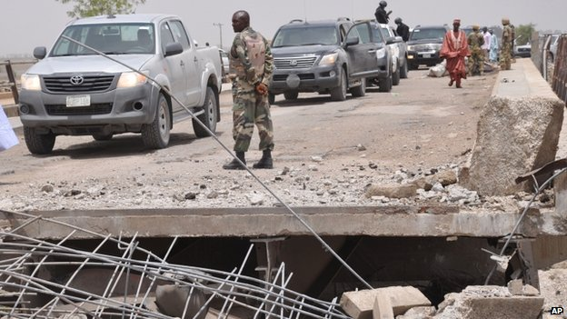 Officials inspects a bridge that link Nigeria and Cameroon following a suspected Boko Haram attack. Photo: May 2014