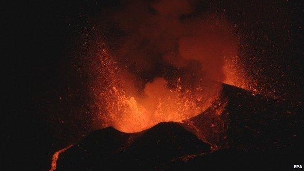 Lava explodes from a volcano next to the village of Portela on Fogo Island November 28, 2014