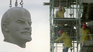 The huge granite head of Berlins Lenin statue is hanging at a crane during its dismantling in Berlin November 13, 1991.