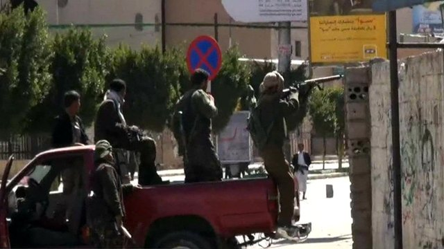 Houthi rebels overlook the presidential palace in Yemen