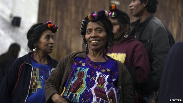 An indigenous woman smiles after hearing the sentence handed down to former police chief Pedro Garcia Arredondo at the Supreme Court in Guatemala City on 19 January, 2015.