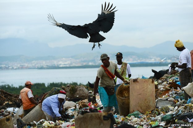 Pickers on the dump with a bird flying overhead