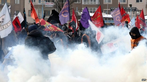 Protesters walk among tear gas smoke during a demonstration in front of the courthouse in Kayseri