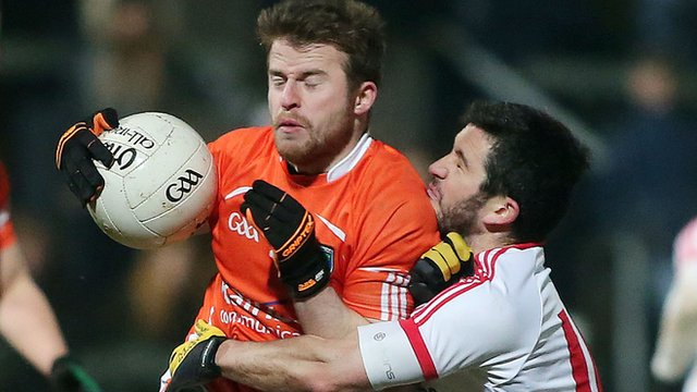 Armagh's Michael Murray feels the force of this tackle from PJ Lavery