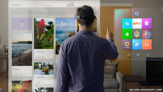 Publicity photo showing model wearing Microsoft HoloLens and scrolling through virtual Windows menu
