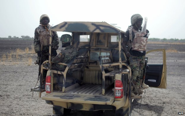 Nigerian soldiers patrol in the north of Borno state on June 5, 2013 near Marte