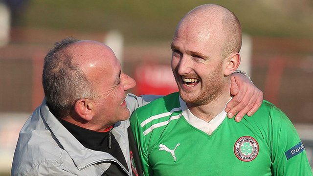 Cliftonville manager Tommy Breslin with Ryan Catney