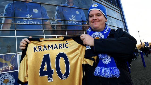 Leicester fan holds up Andrej Kramaric shirt