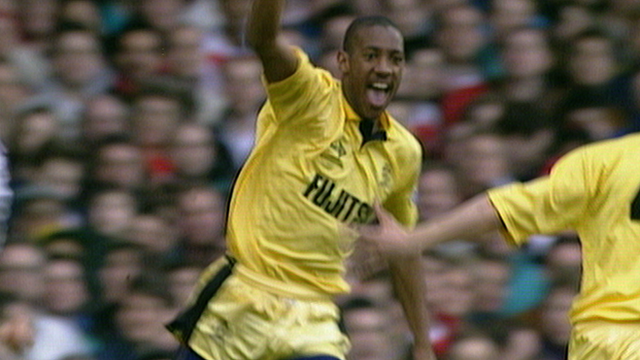 Dion Dublin celebrates scoring for Cambridge