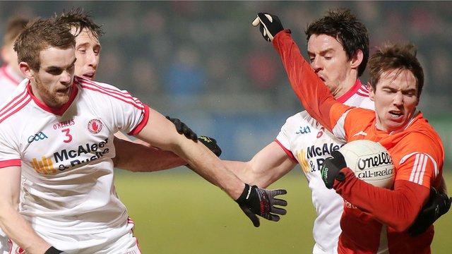 Tyrone's Ronan McNamee challenges Armagh forward Tony Kernan