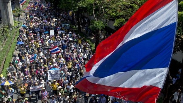 Thai anti-government protesters wave national flags during a rally in Bangkok on May 12, 2014.