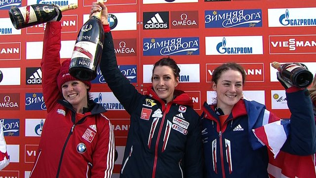 Elisabeth Vathje, Janine Flock and Laura Deas celebrate at the the skeleton World Cup event at St Moritz