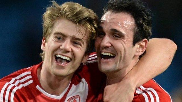 Middlesbrough goal scorers Patrick Bamford and Kike celebrate beating Man City in FA Cup