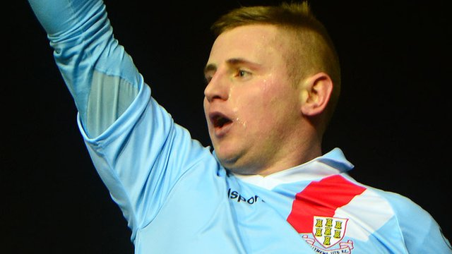 David Cushley celebrates after scoring Ballymena's first goal against Cliftonville