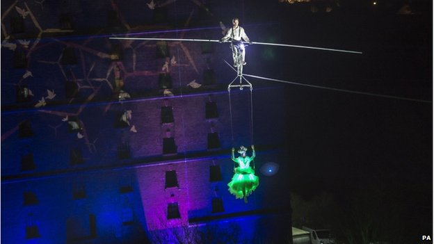 Cyclist rides on high wire between Bristol warehouses