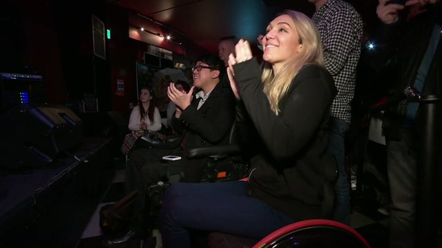 Wheelchair users at a gig in London