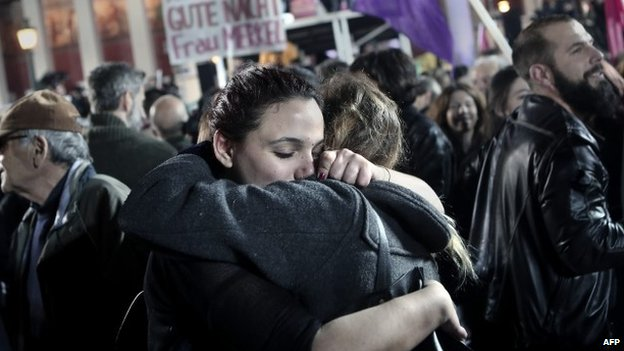Anti austerity Syriza party supporters celebrate as leader Alexis Tsipras speaks following victory in the election in Athens on January 25, 2015
