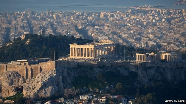 The sun begins to rise over Athens and the Acropolis seen from the summit of Mount Lycabettus following the electoral success by Syriza in the Greek general election yesterday on January 26, 2015 in Athens, Greece