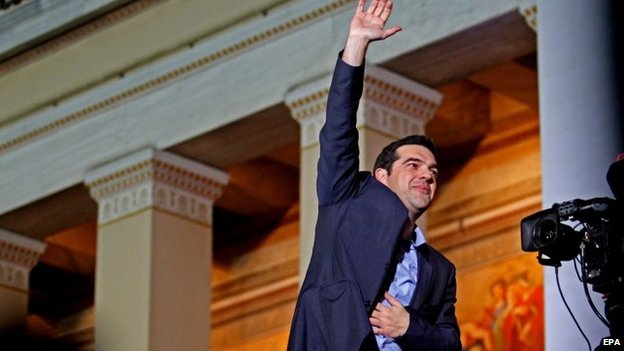 Alexis Tsipras, opposition leader and head of radical leftist Syriza party, greets supporters after the initial election results for the Greece general elections in Athens, Greece, 25 January 2015